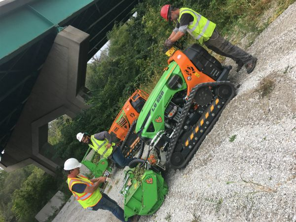 remote-operated mower, an excavator with mower head attachment and skytrim mechanical trimmer
